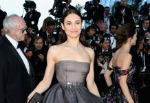 Olga Kurylenko is dressed in Dior