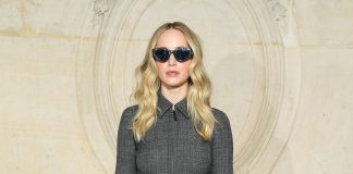 Jennifer Lawrence wore a Dior Fall-Winter 2019-2020 grey wool and silk dress, a Dior black leather belt, Dior sunglass and Dior shoes.