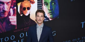 Miles Teller wearing Burberry