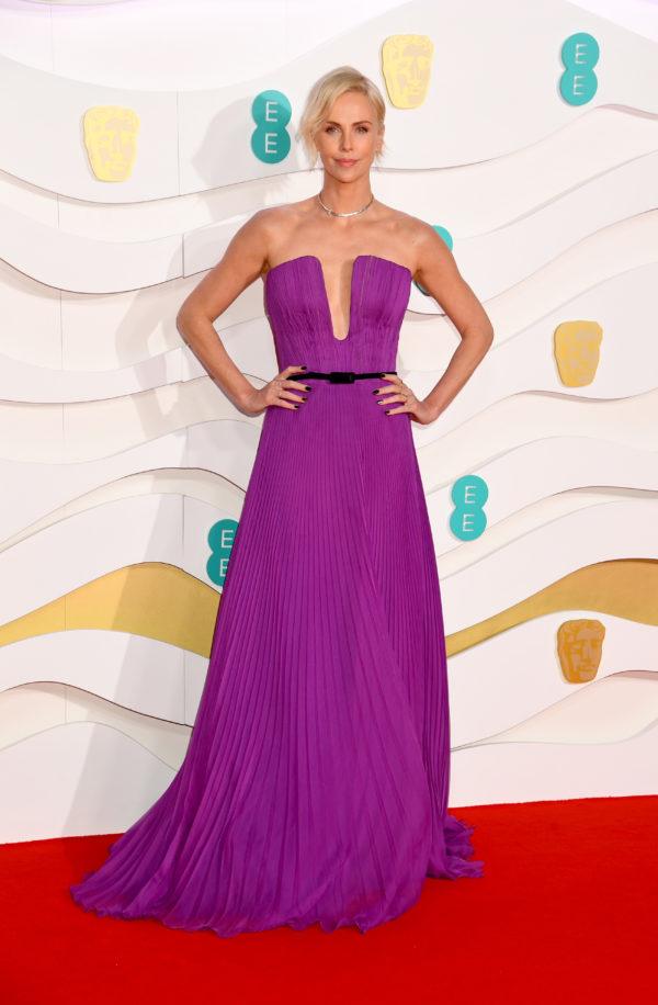 Charlize Theron dressedin Dior Haute Couture by Maria Grazia Chiuri to theEE British Academy Film Awards
